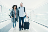 Young couple with a suitcase ready for travel