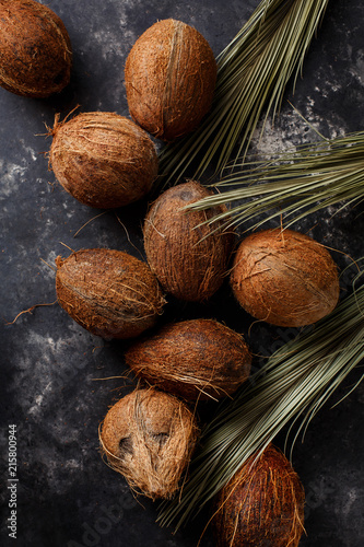 Foto Murales Coconuts on a dark background.