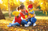 happy family mother and children on   autumn walk - 215804724