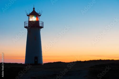 Canvas Noordzee Silhouette of Lighthouse List-West after sunset.