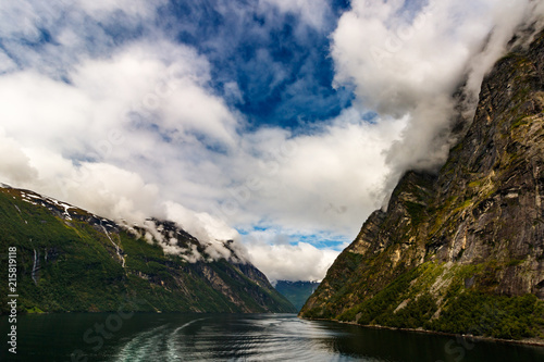 Foto Murales Landscape of the mountains with cloudy sky. Beautiful nature in Norway,Geiranger fjord - 7 Sisters Waterfall with an average fall of 250 m, which is an amazing view when the water level is high.