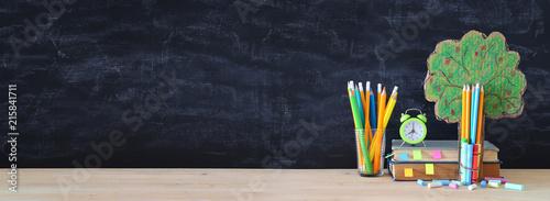 Leinwandbild Motiv Back to school concept. tree of knowledge and pencils in front of classroom blackboard.
