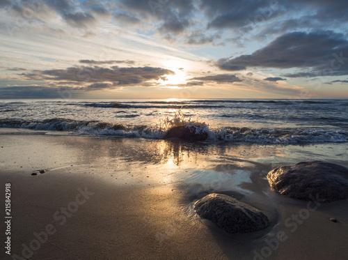 Fotobehang Zee zonsondergang Beautiful sunset on the sandy beach of the Baltic Sea in Lietva, Klaipeda