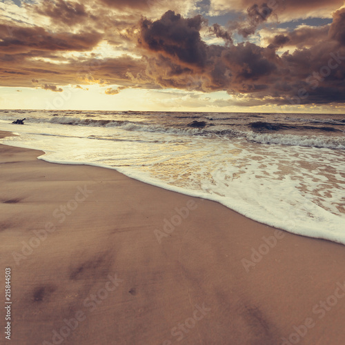 Foto Spatwand Strand Beatiful sunset with clouds over sea and beach