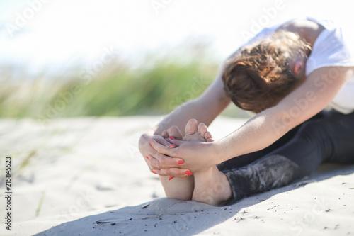 Leinwanddruck Bild Yoga on the beach