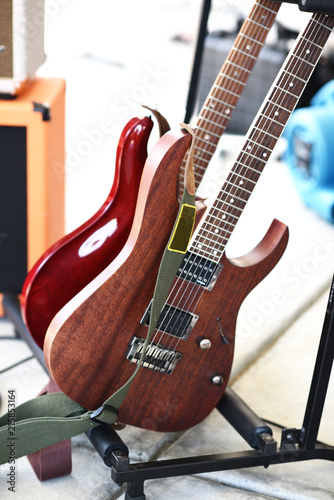 Two electric guitars in a rack. - 215853164