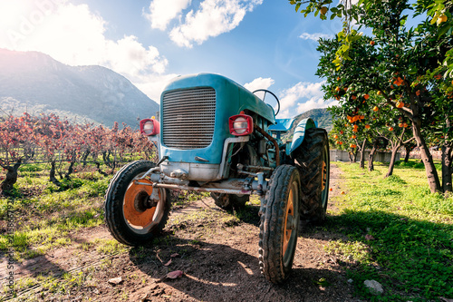 Fotobehang Trekker Old light blue tractor for agricultural crops