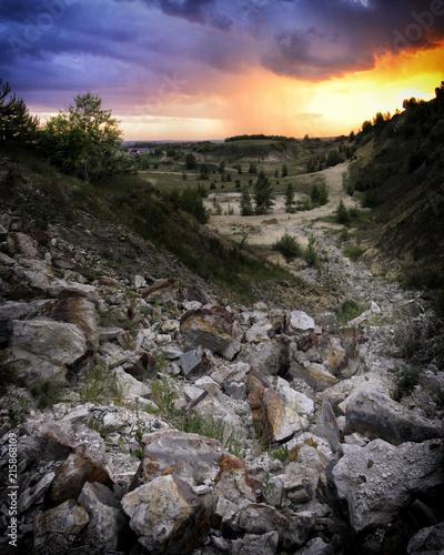 Fotobehang Grijze traf. Stone river at sunset