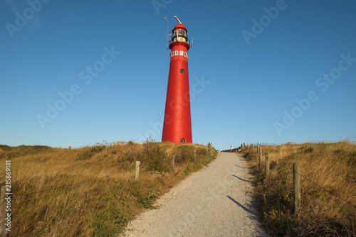 Aluminium Blauwe jeans The red North Tower lighthouse on the Dutch island Schiermonnikoog, The Netherlands