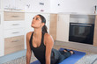 Woman doing yoga in a kitchen