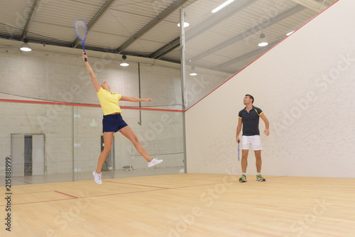 Aluminium Tennis determined young man and woman playing tennis indoor