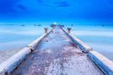 Jetty bridge on to the sea in blue summer sky for boat and ship. Long exposure Technic therefor smooth and  blurred sea water surface
