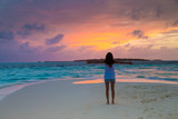 woman relax on the beach. Vacation at Paradise. Ocean beach relax, travel to Maldives islands - 215927902