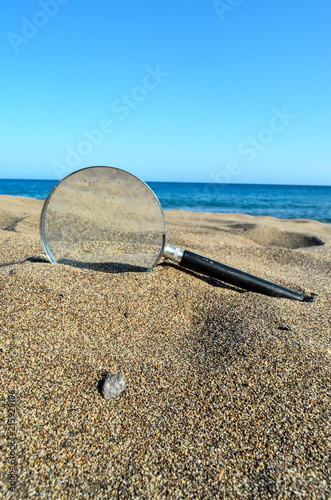 Sticker Magnify Glass on the Sand Beach