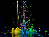 Abstract sculptures of colorful splashes of paint. Dancing liquid on a black background. Ink water splash. Color explosion. - 215935394