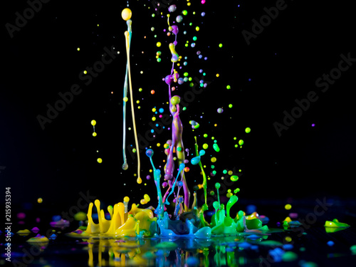 Foto Murales Abstract sculptures of colorful splashes of paint. Dancing liquid on a black background. Ink water splash. Color explosion.