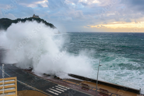 Leinwandbild Motiv Waves breaking on New Promenade of San Sebastian, Spain