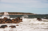 Coast of the Atlantic Ocean.  A sailboat floating among the waves. Maine. Portland.