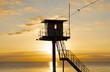 Leinwandbild Motiv Rettungsturm am Strand - Sonnenuntergang