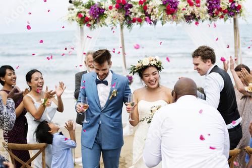 Leinwanddruck Bild Cheerful newlyweds at beach wedding ceremnoy