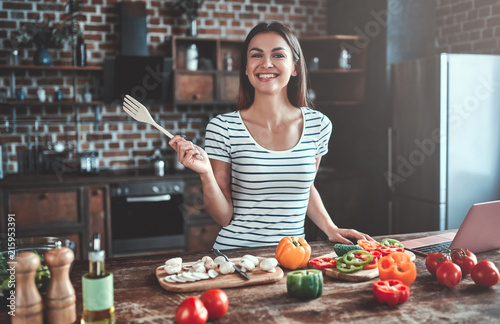 Young woman on kitchen - 215953391