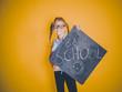 Leinwandbild Motiv beautiful blond girl with glasses holding blackboard with the words back to school on it