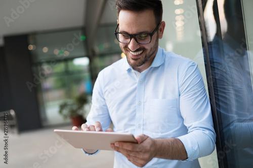 Foto Murales Man in white shirt using tablet