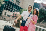 Smiling young travellers couple looking for hotel - 215986704