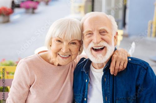 Leinwandbild Motiv Strong relationships. Gay senior couple making laugh and looking at camera