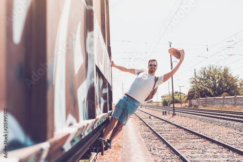 Foto Murales man traveling in train carriage