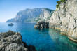 Quadro Dramatic scenic view of turquoise cove at the foot of dramatic cliffs the Mediterranean island of Capri, Italy