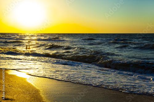 Plexiglas Geel Beautiful sea at sunset.