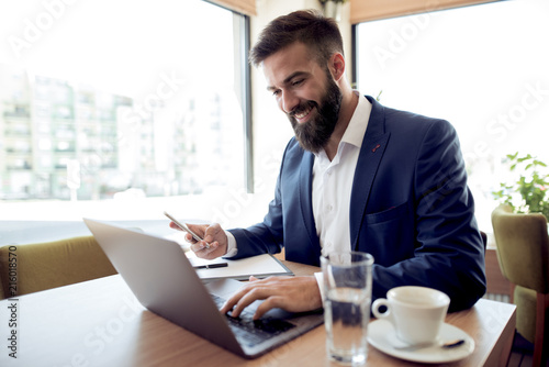 Businessman working in office - 216018570