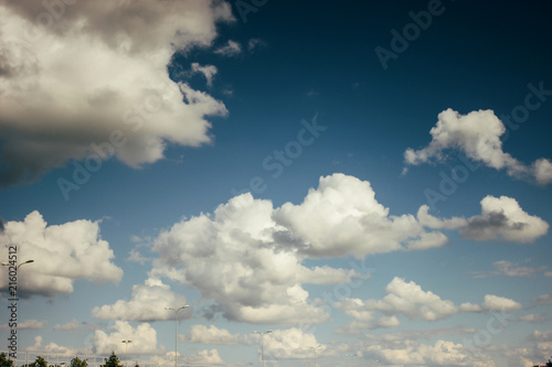 beautiful amazing view of sky and clouds on highway road near airport - 216024512