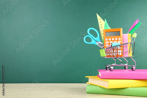 School supplies with books on chalkboard background - 216025791