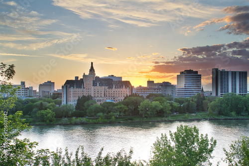 Foto Spatwand Canada Sunset Over a River and City