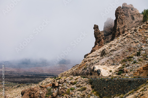 Foto Murales Boca Tauce scenic road in the fog through the Mountain Teide National Park