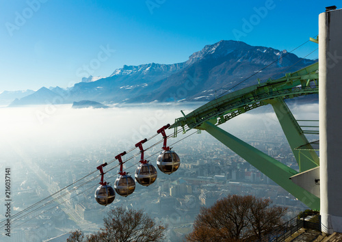 Foto Murales Cityscape with cable cars in Grenoble in autumn, France