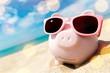 Leinwanddruck Bild - Piggy Bank Wearing Sunglasses Relaxing