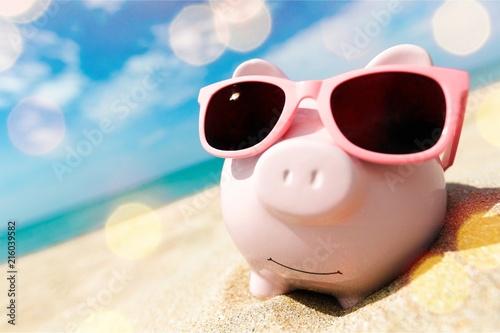 Leinwanddruck Bild Piggy Bank Wearing Sunglasses Relaxing