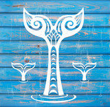 White Whales Tail on Rustic Wood Background