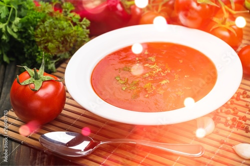Fresh tomato soup on desk - 216045703