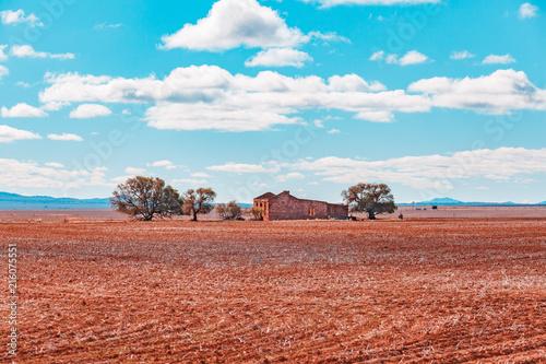 Plexiglas Pool Old ruins in plowed field in South Australia outback