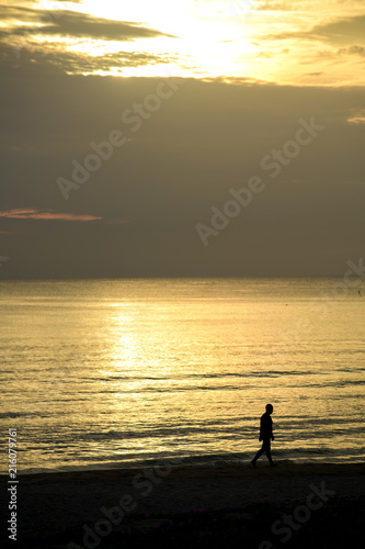 Fotobehang Zee zonsondergang People stood watching the sea, Sunrise and happy
