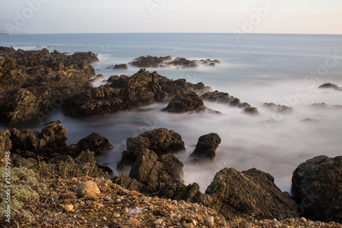 Foto Murales Picturesque view of rocks on coast