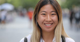Young Asian woman in city smile happy face portrait - 216089766