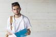 Leinwandbild Motiv student portrait with notepad or outdoor books