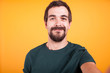 Quadro Close up selfie portrait of happy smiling man isolated on yellow background