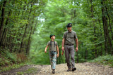 Ranger and his son in the woods - 216120390
