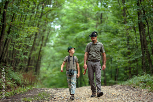 Leinwandbild Motiv Ranger and his son in the woods
